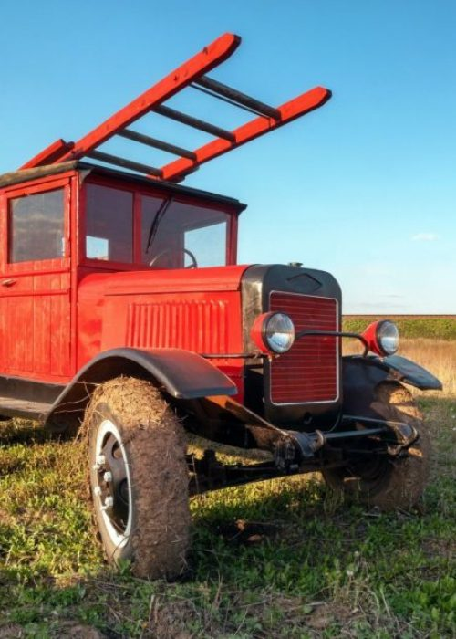 Old retro red fire truck with wooden case